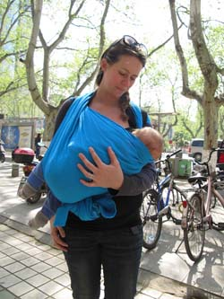 nursing in a baby wrap newborn LLA